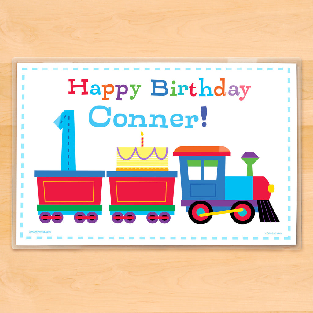 Kids birthday placemat. Colorful train on a white background carrying a birthday cake and birthday number, personalized with child's name.