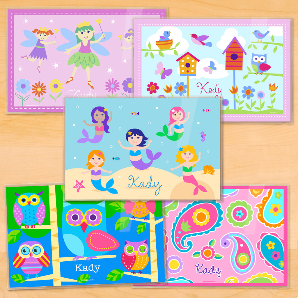 Set of 5 personalized placmats. One each of Mermaids in an ocean scene, Owls on a blue background, Fairies on pink background, Birds and Birdhouses, and Pink Paisley.