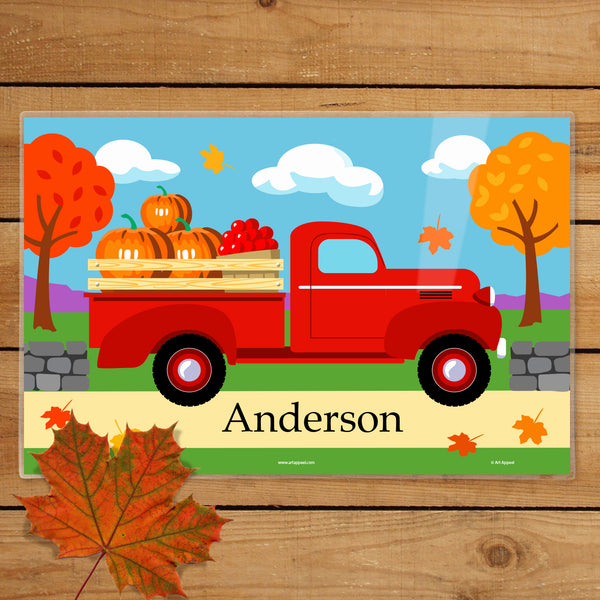 Kids autumn personalized placemat for snack time lunch dinner and breakfast table setting with red pickup truck and fall leaves