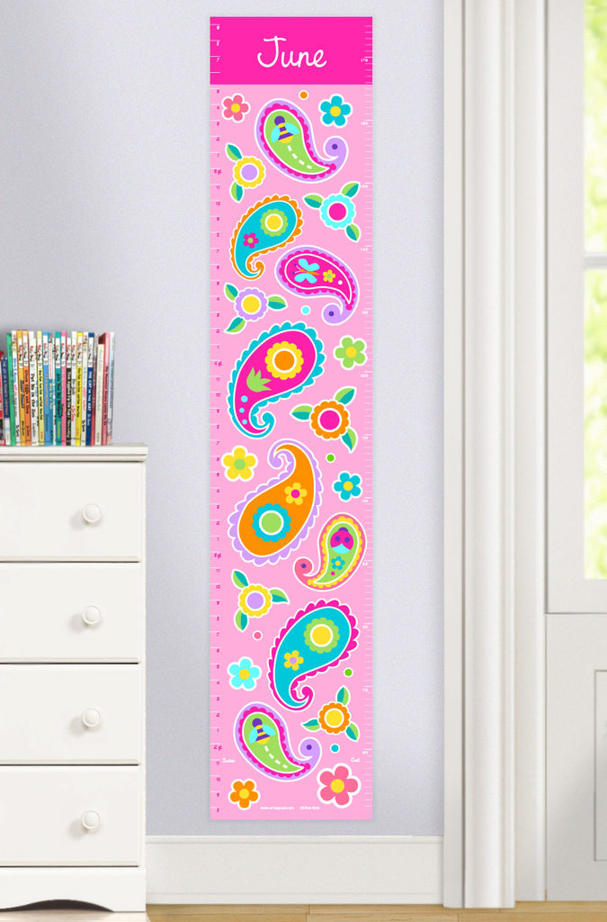 Personalized Paisley Growth Chart with Colorful paisley design on a light pink background. Child's name at top on a bright pink band. Photographed in a room scene.