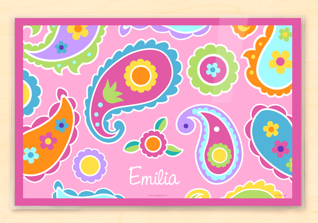 Personalized Kids Placemat with a pink paisley design with colorful flowers and paisleys on a pink background