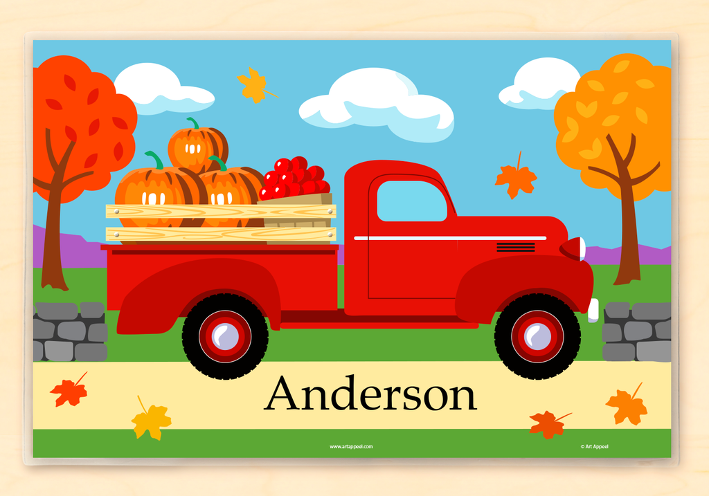 Fall pickup truck personalized kids placemat with red truck, colorful leaves, pumpkins, and stonewall