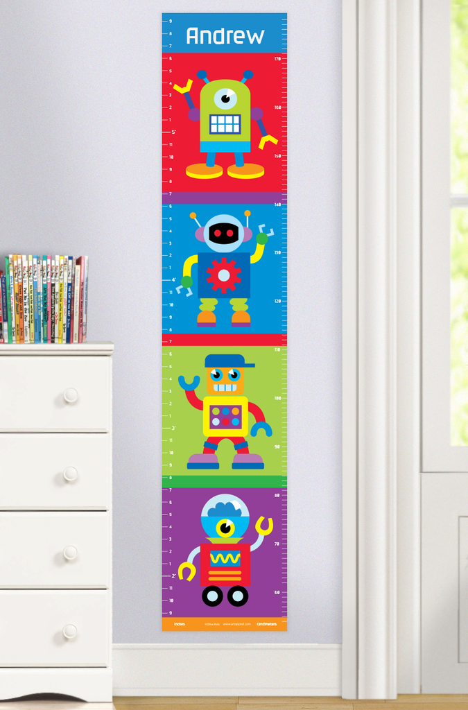 Robots personalized growth chart with 4 colorful little robots on red, bule green a nf purple backgrounds. Personalized with childs name at the top. Photographed in room setting.
