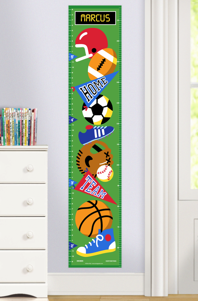 Sports Growth Chart with Sports Balls, Sports Equipment, and pennants on a green background, with Child's name at top. Photographed in room setting.