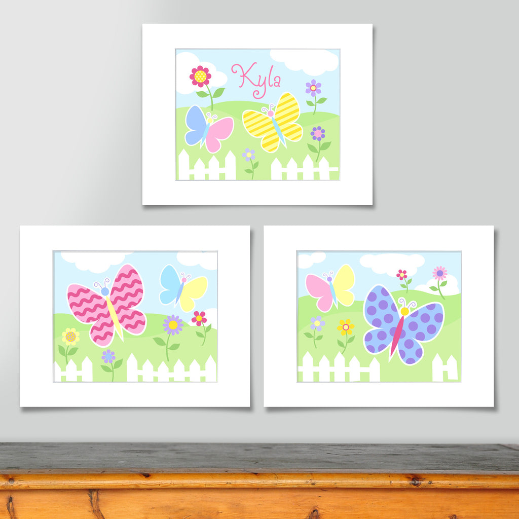 Set of 3 coordinating butterfly prints. Softly colored butterflies in landscape with picket fence and flowers.One print is personalized with childs name.