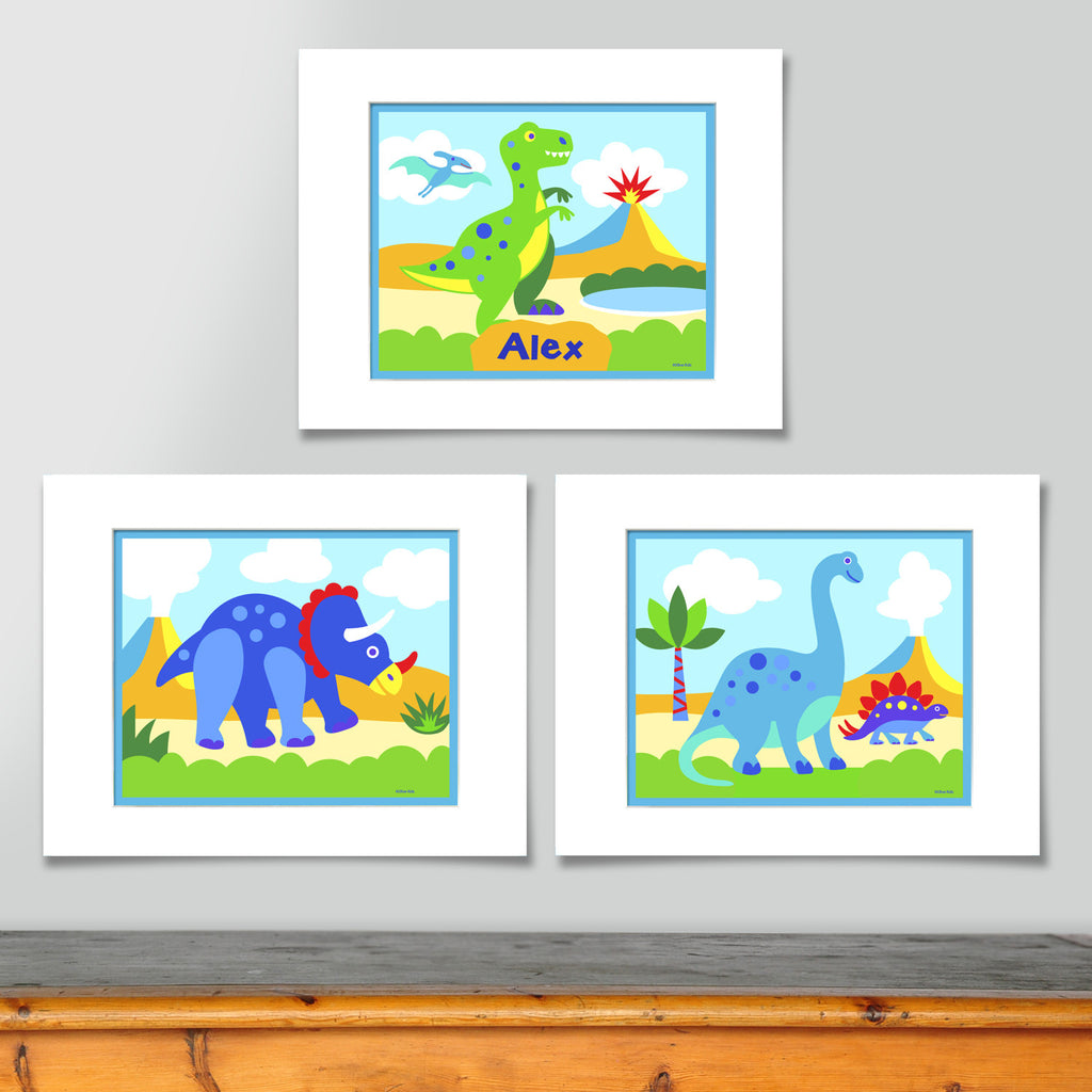 Set of 3 coordinating dinosaur prints. Personalized print features green T-rex in prehistoric landscape. Second features triceratops in landscape, third print features brontosaurus in landscape. Brightly colored with blues and greens.