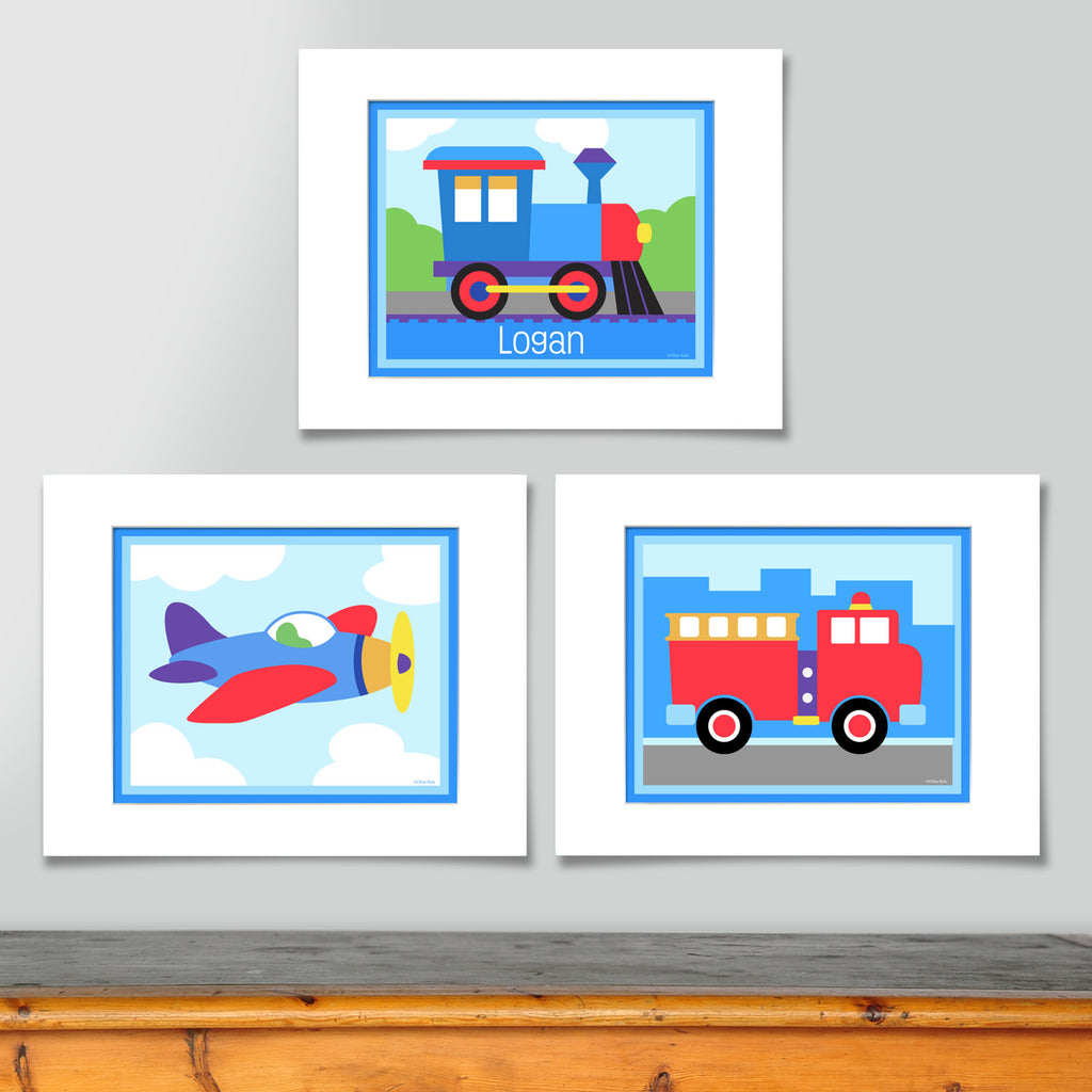 Transportaion prints include, colorful train engine personalized with childs name, airpalne in sky with clouds, and red fire engine in front of a simple city skyline.