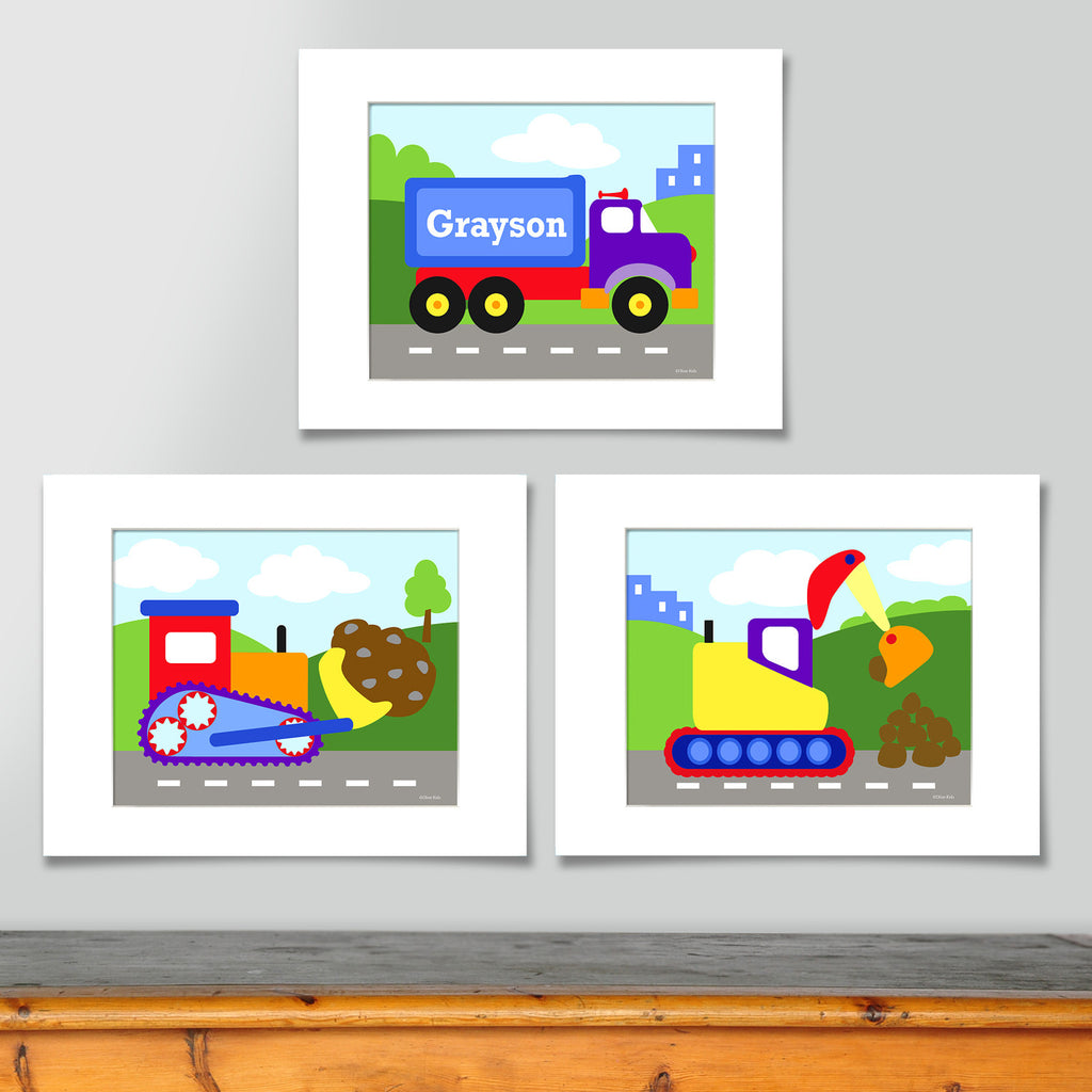 Colorful construction themed personalized art print set . Prints include a personalized tractor trailer truck, a colorful bulldozer and a digger, all on construction site backgrounds.
