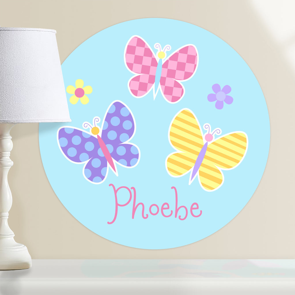 Kids personalized circular wall decal. Pink, blue and yellow butterflies on a light blue background.