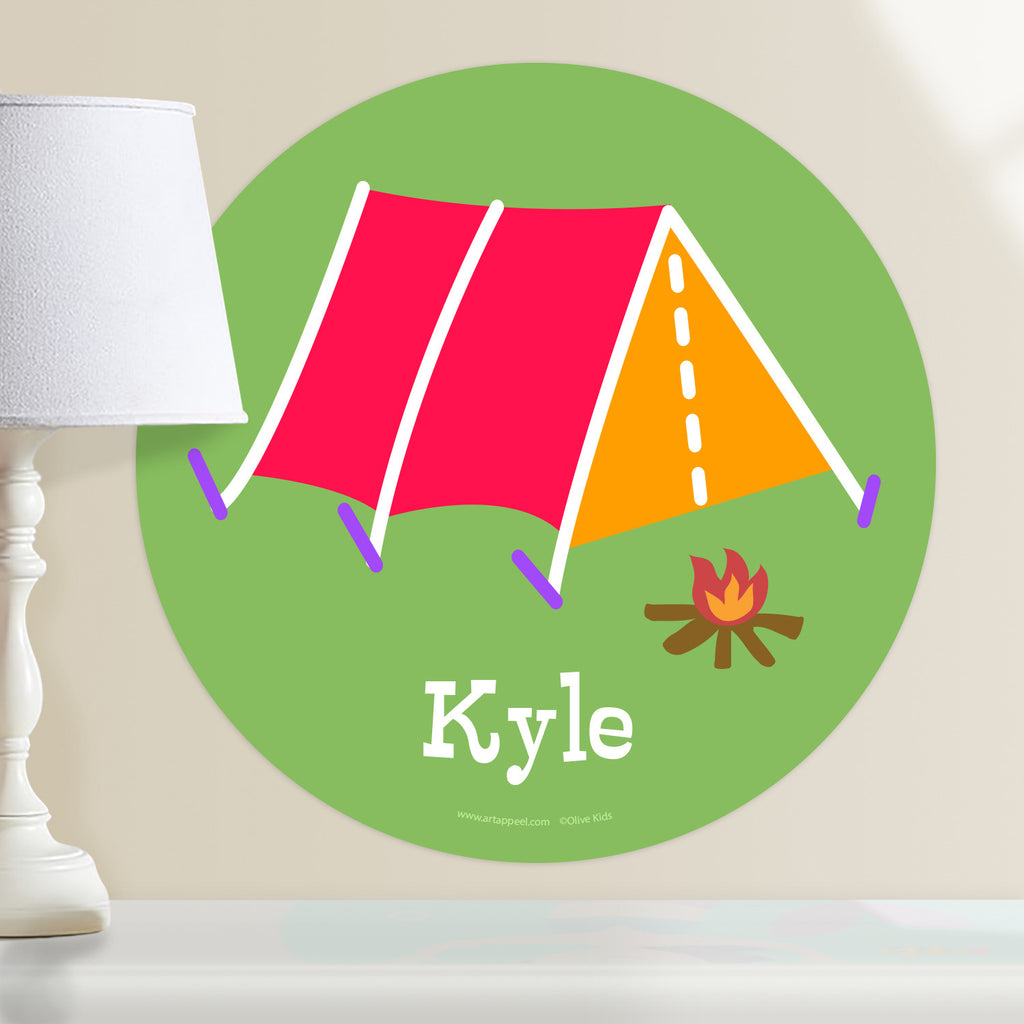 Kids personalized circular camping tent wall decal. Red and orange tent on a green background.