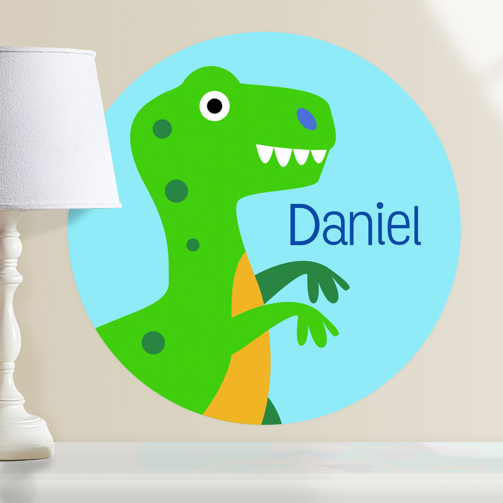 Kids personalized dinosaur circular wall decal. Green T-rex on a light blue background.