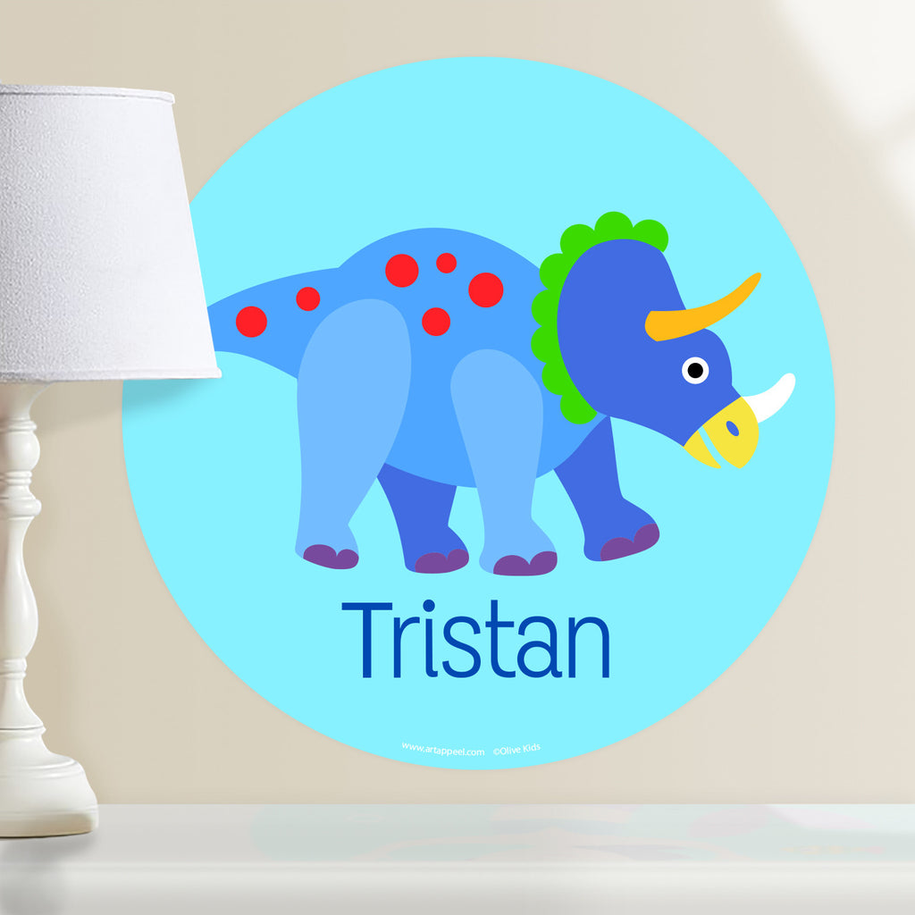 Kids personalized dinosaur circular wall decal. Blue and red dino on a light blue background.