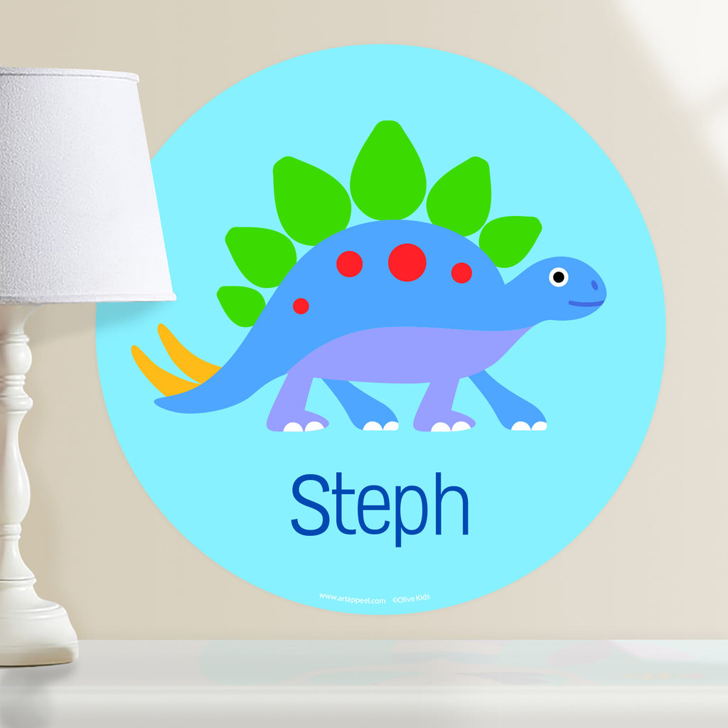 Kids personalized circular wall decal.Blue, green and purple dinosaur on light blue background.