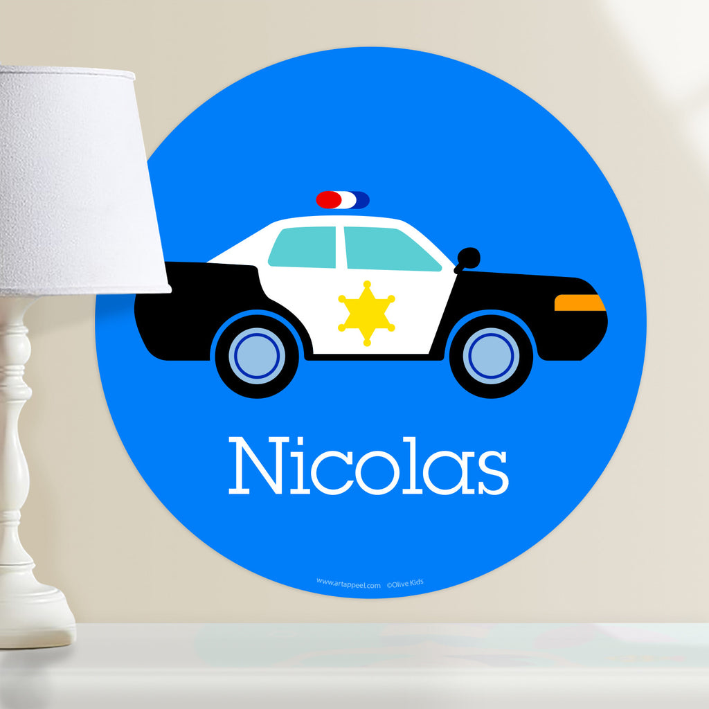 Personalized kids hero themed wall decal.  Black and white police car on a blue background.