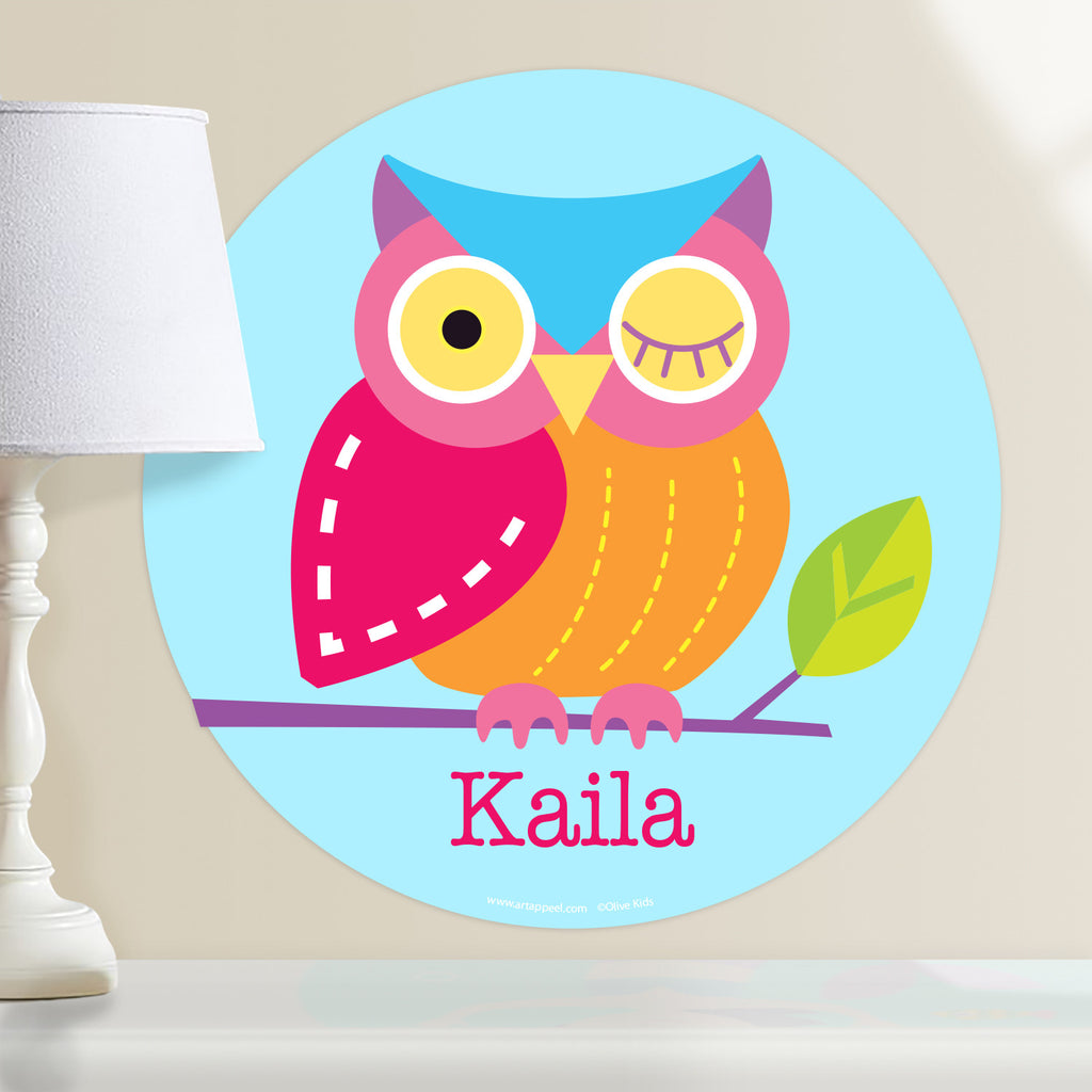Owl personalized kids circular wall deca.l Colorful owl sitting on a branch on a light blue background.