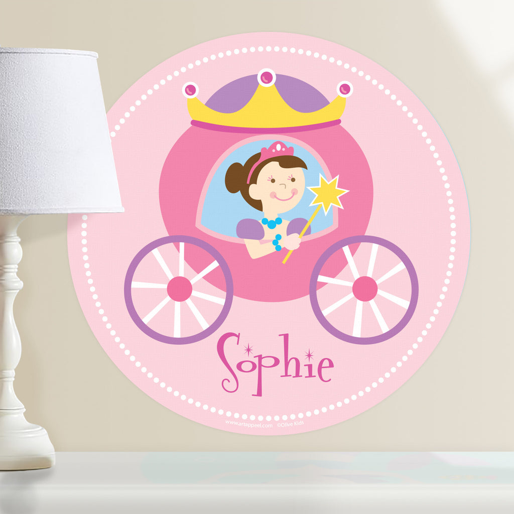 Princess personalized wall decal.  Circular shape, with dark hair princess sitting in her pink and purple coach. Light pink background.