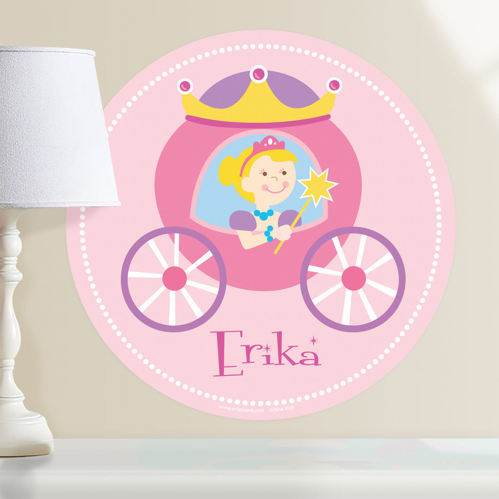 Princess personalized wall decal.  Circular shape, with blonde princess sitting in her pink and purple coach. Light pink background.