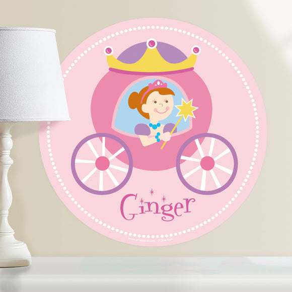 Princess personalized wall decal.  Circular shape, with red hair princess sitting in her pink and purple coach. Light pink background.