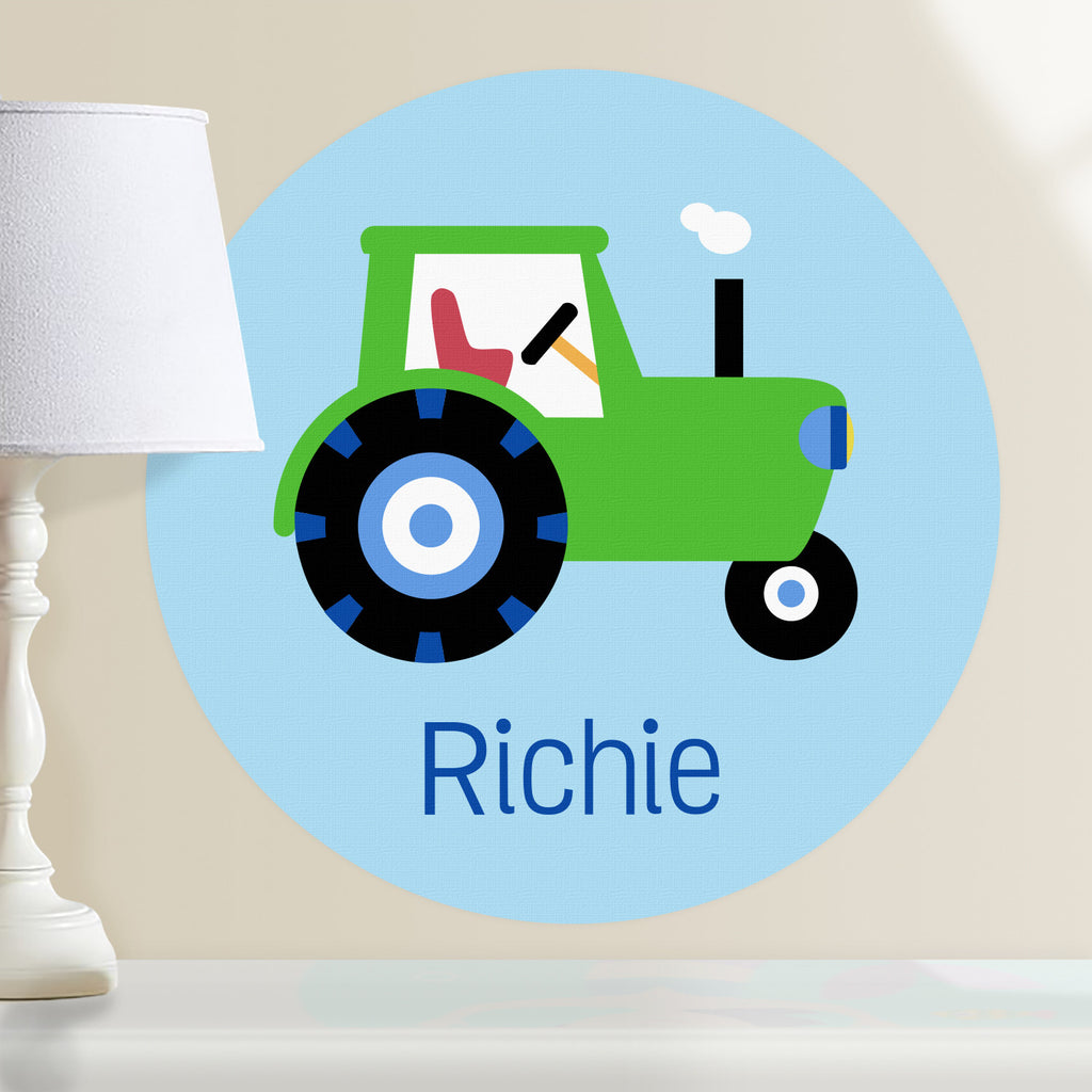 Personalized kids tractor wall decal.  Green tractor on a light blue background. Circular shape decal.