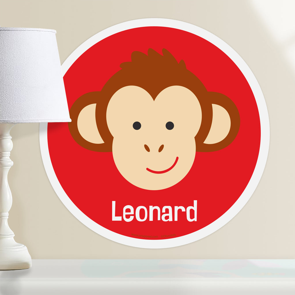 Kids personalized circular wall decal. Happy baby monkey portrait on a red background.