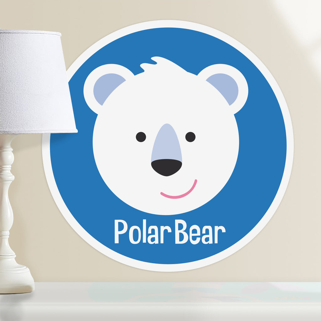Kids personalized circular wall decal. Happy baby polar bear on a blue background.