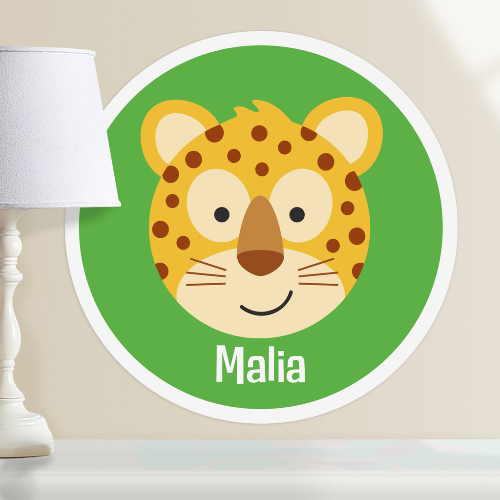 Kids personalized circular wall decal. Happy baby leopard on a bright green background. background.