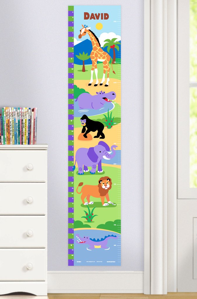 Wild Animals Growth Chart with lion, elephant, giraffe, hippo, gorilla, and crocodile on a grass background. Childs name at top. Photographed in a room setting.