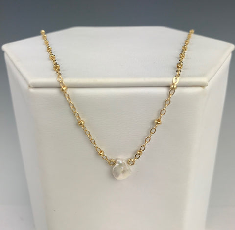 Side to Side Gold Pearl Necklace