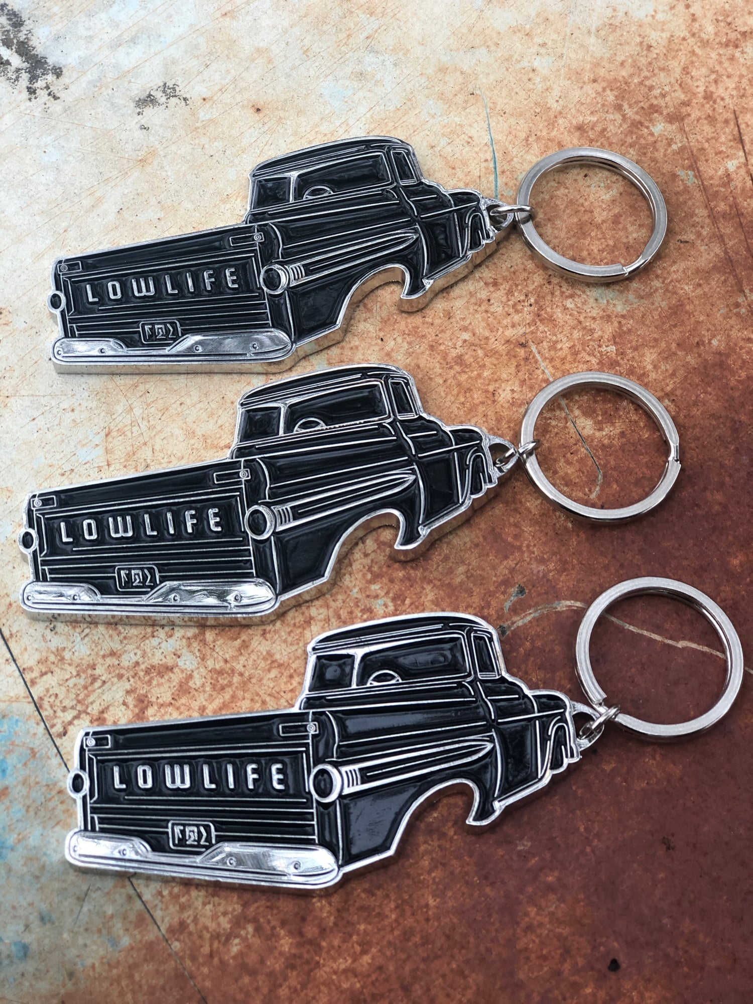 The LowLife Fleetside Bottle Opener key Chain