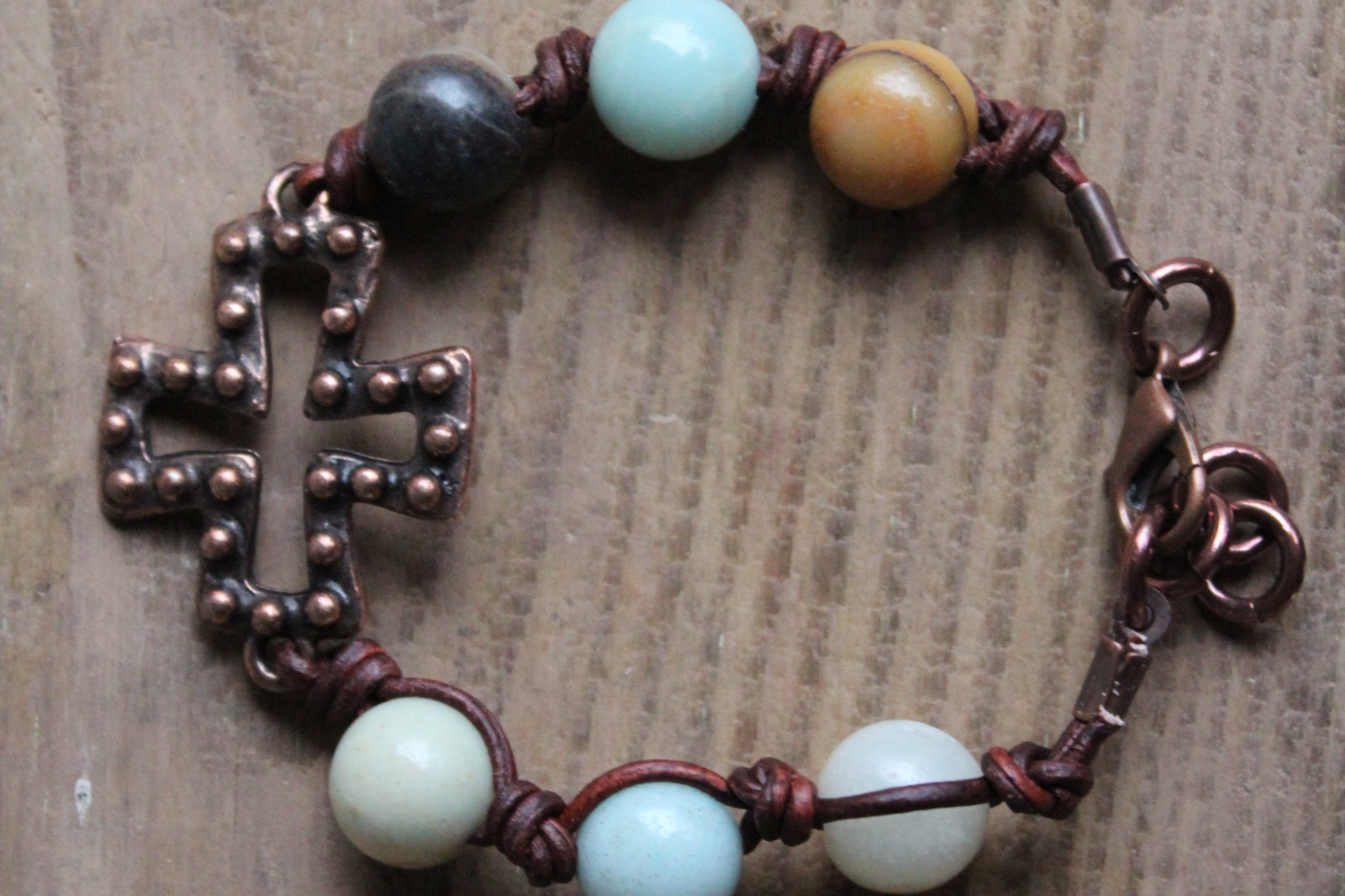 B031C; Bracelets; Open Coppertone Studded Cross; Knotted Black Leather; Amazonite Beads; ; ; ; Majestees;