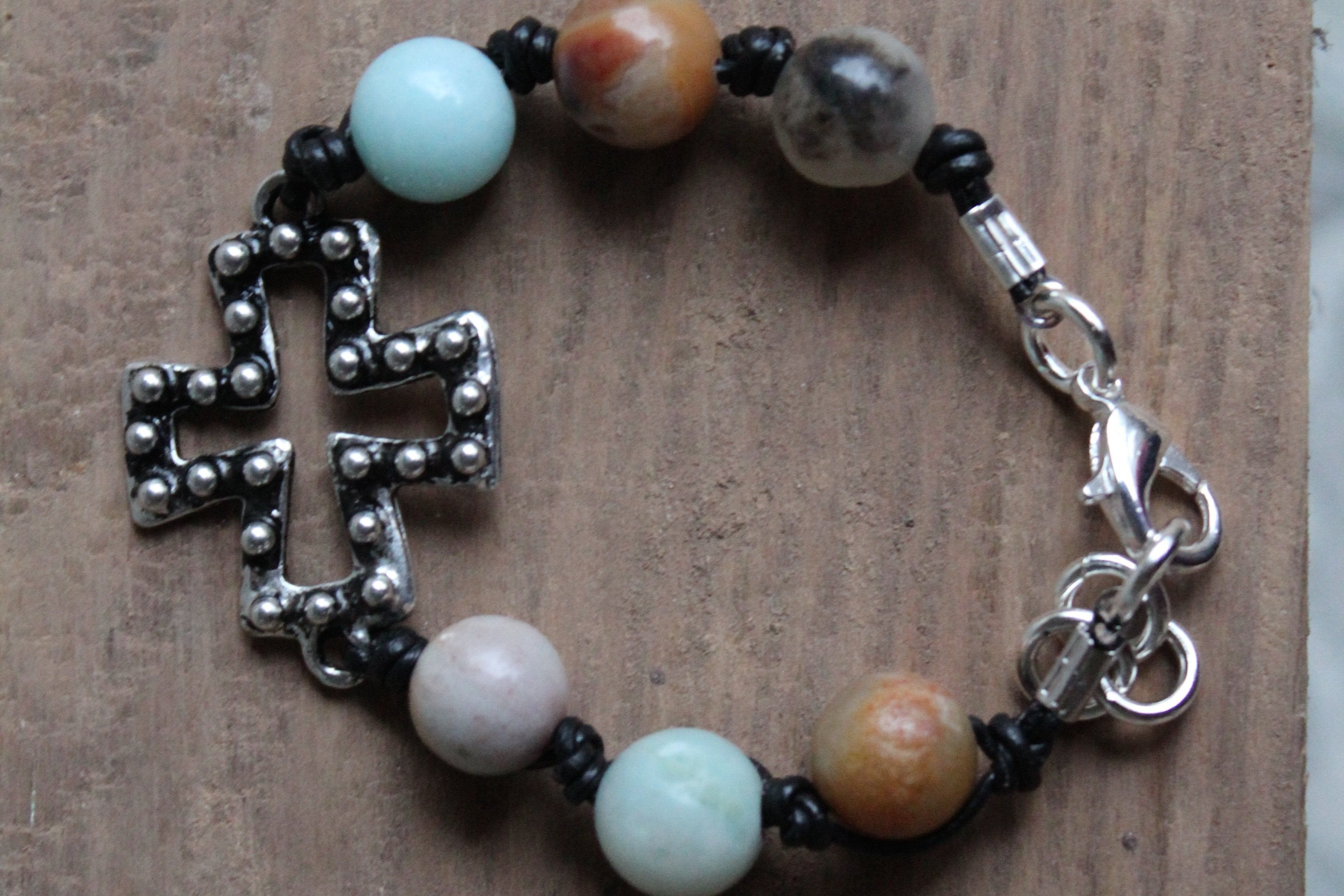 B031PBK; Bracelets; Open Pewter Studded Cross; Knotted Black Leather; Amazonite Beads; ; ; ; Majestees;