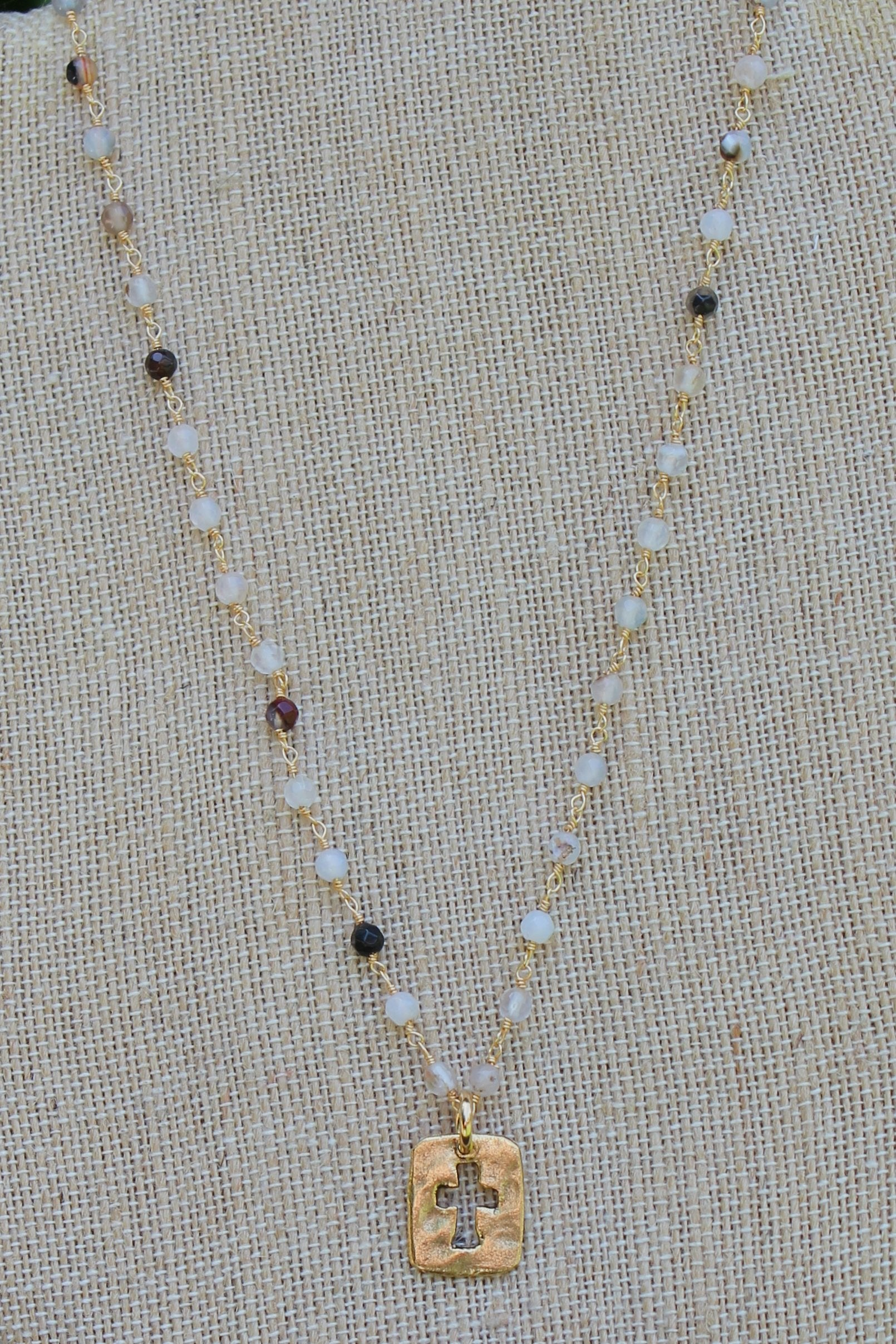 N109GB; Small Goldtone Open Cross; 3mm Black Agate Goldtone Chain; Approximately 17 inches; ; ; ; Majestees