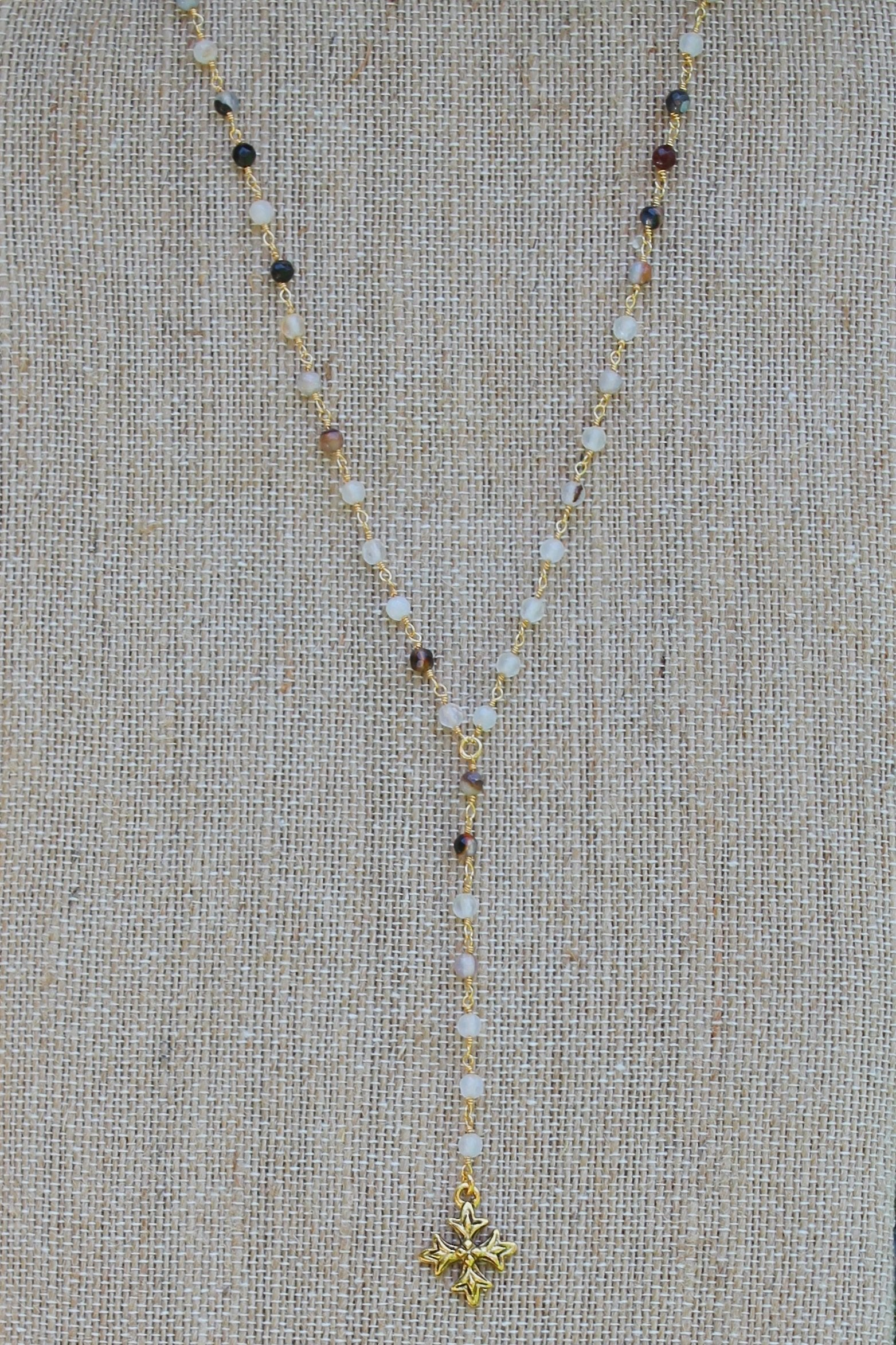"N110GC; Small Fancy Trinity Cross; 3.5"" Drop Chain; 3mm Black Agate Goldtone Chain; Approximately 17 inches; ; ; Majestees"