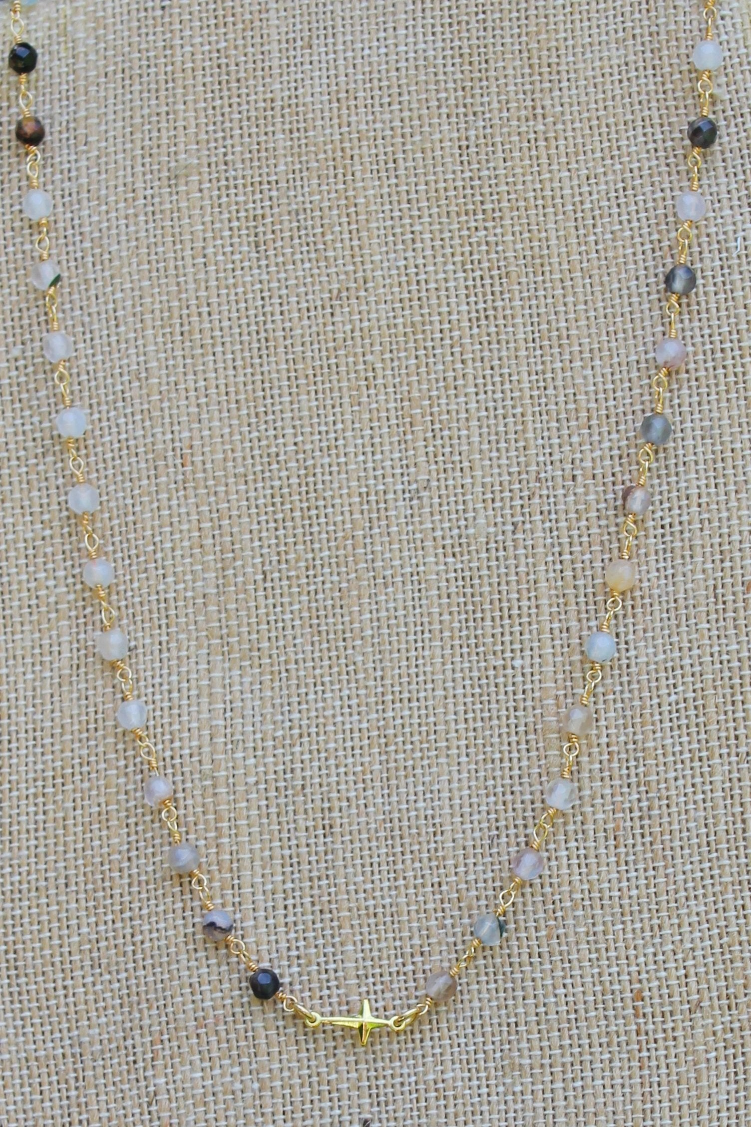 N112G; Tiny Goldtone Cross; 3mm Black Agate Goldtone Chain; Approximately 16 inches; ; ; ; Majestees