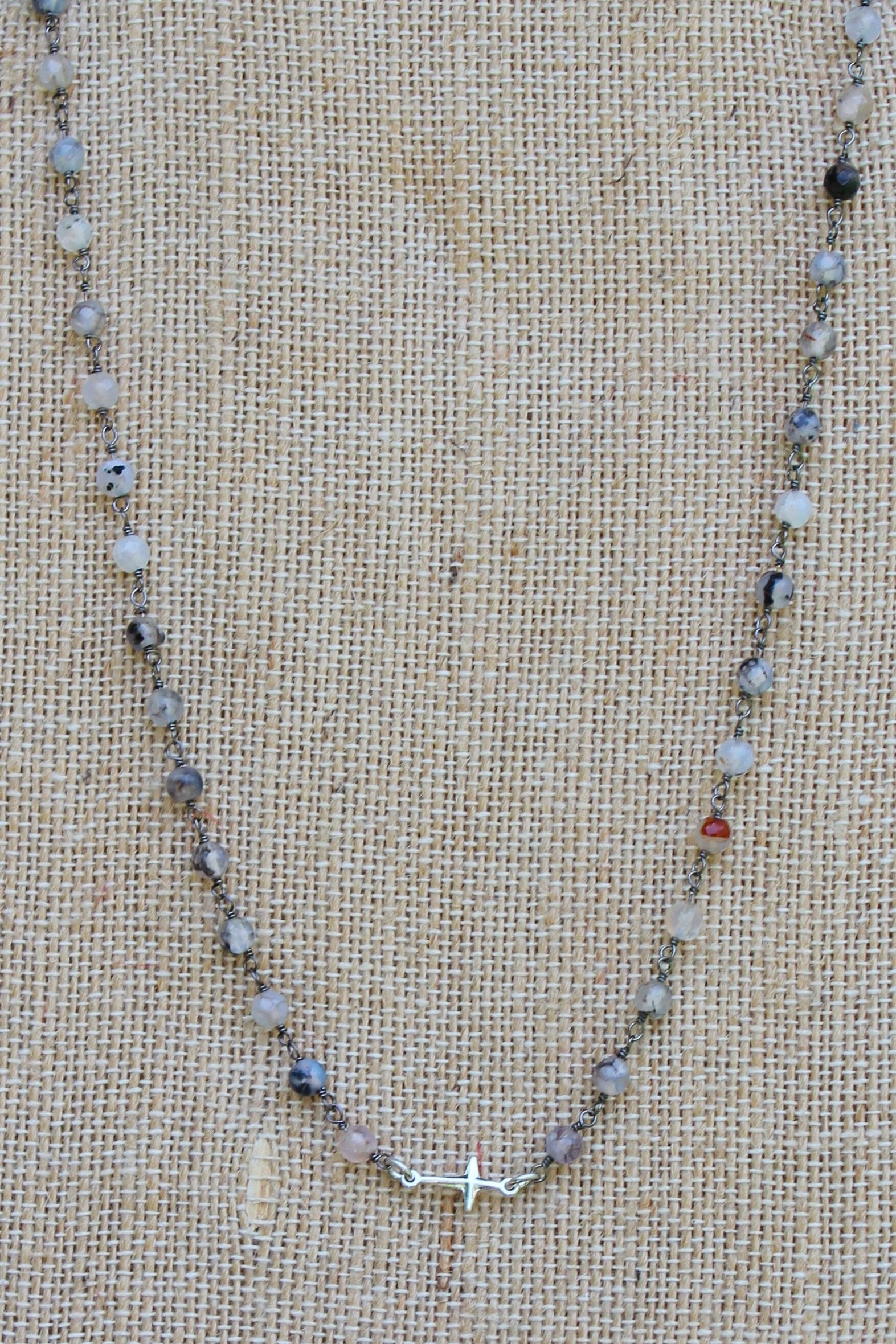 N112S; Tiny Silvertone Cross; 3mm Black Agate Silvertone Chain; Approximately 16 inches; ; ; ; Majestees