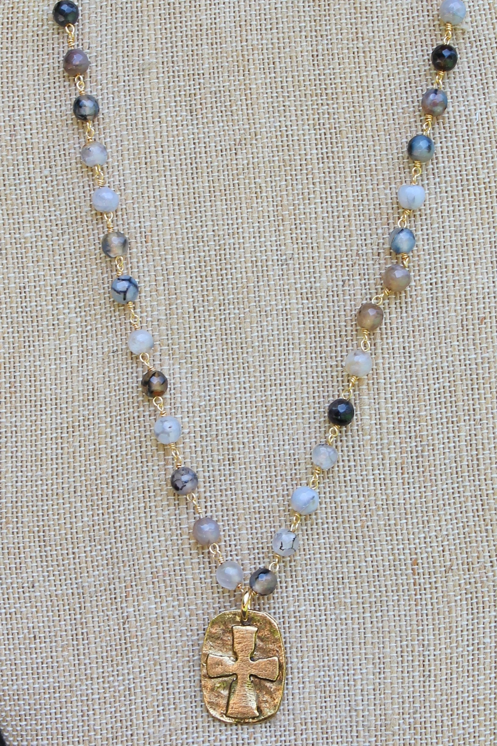 N113GF; Goldtone Relief Cross; 5mm Black Agate Goldtone Chain; Approximately 16 inches; ; ; ; Majestees