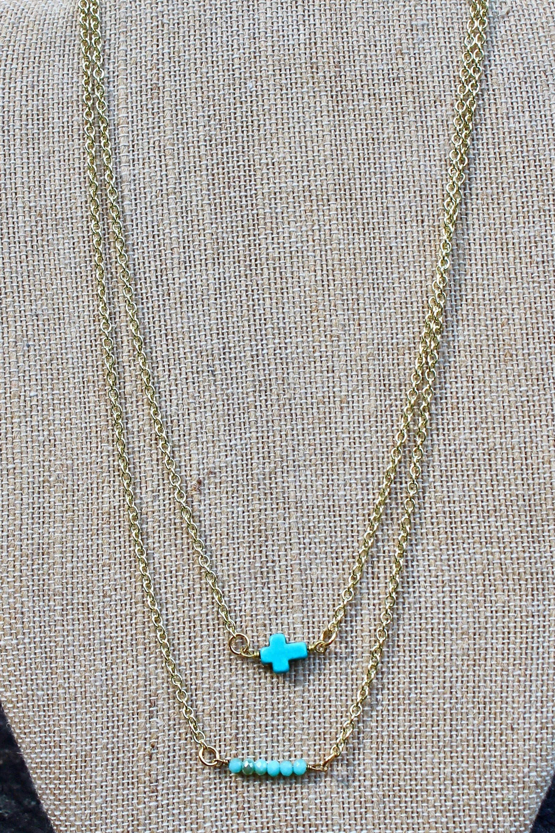 N126GT; Turquoise Stone Sideways Cross; Wired with Double Goldtone Chain; Approximately 16 inches; ; ; ; Majestees