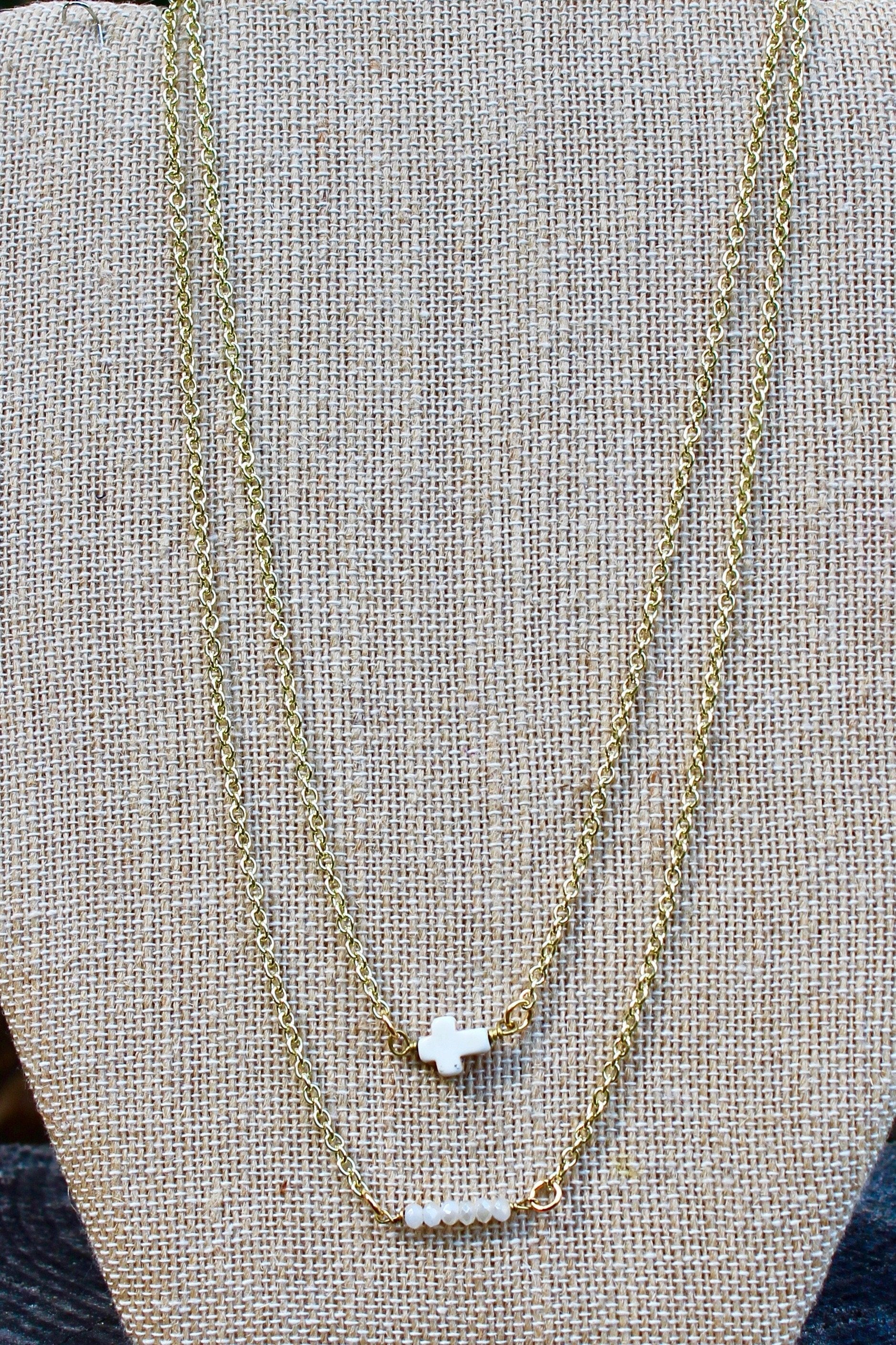 N126GW; White Stone Sideways Cross; Wired with Double Goldtone Chain; Approximately 16 inches; ; ; ; Majestees
