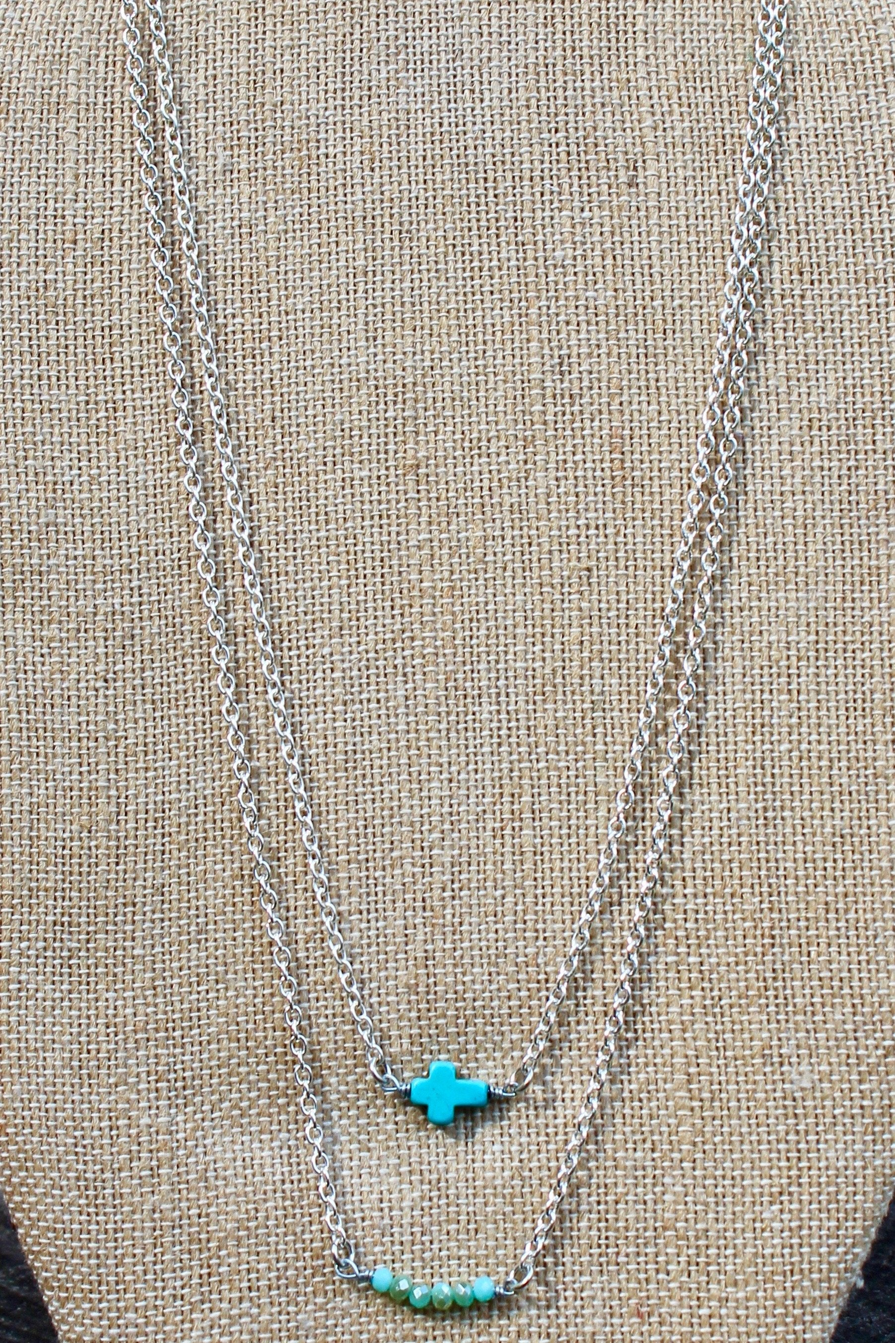 N126ST; Turquoise Stone Sideways Cross; Wired with Double Silvertone Chain; Approximately 16 inches; ; ; ; Majestees