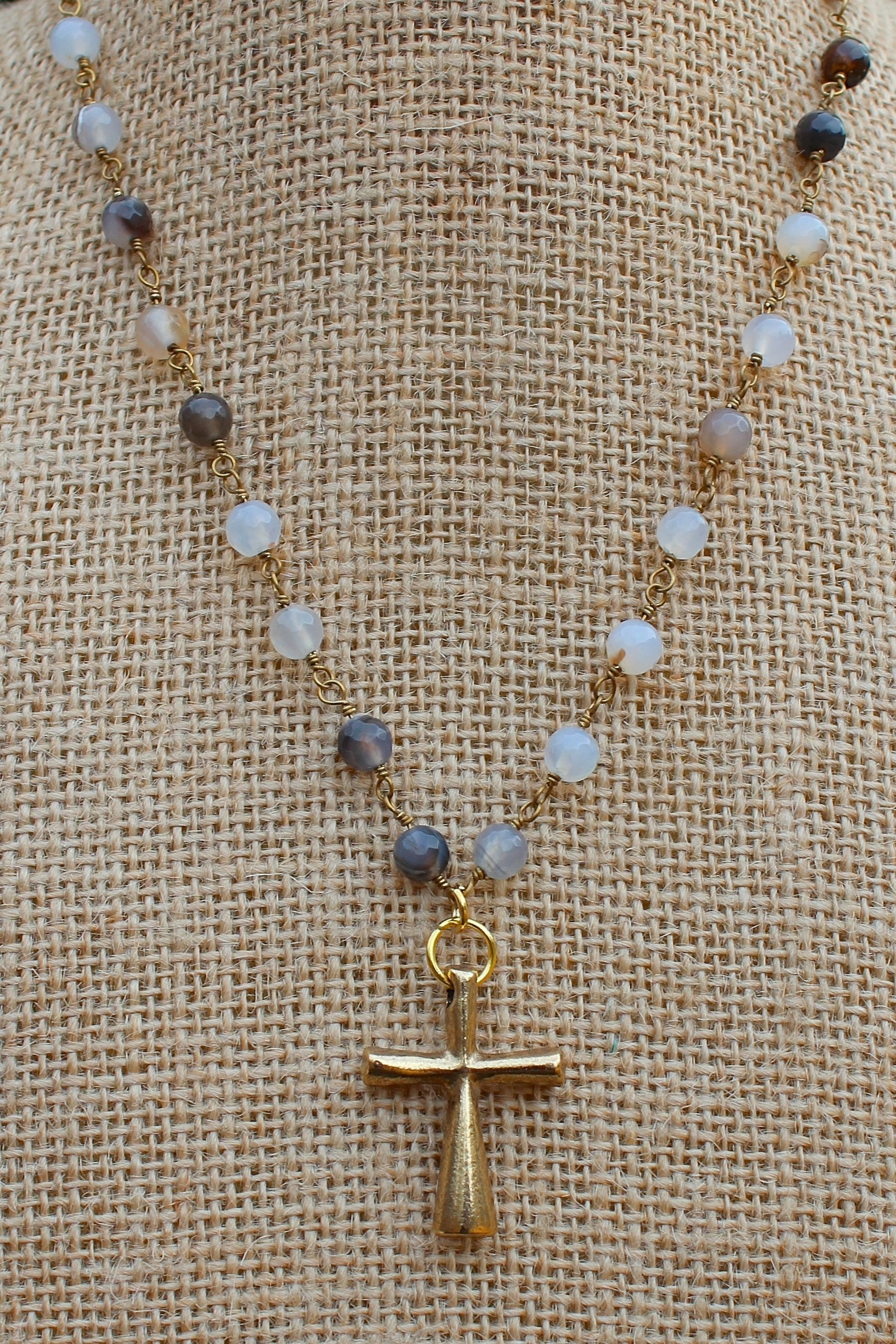 N127GB; Tubular Goldtone Cross; 5mm Goldtone Black Agate Chain; Approximately 16 inches; ; ; ; Majestees