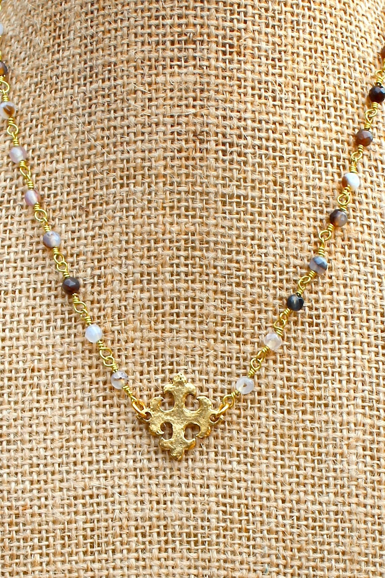 N129GB; Hammered Goldtone Fleur-de-lis Cross; 3mm Goldtone Black Agate Chain; Approximately 16 inches; ; ; ; Majestees