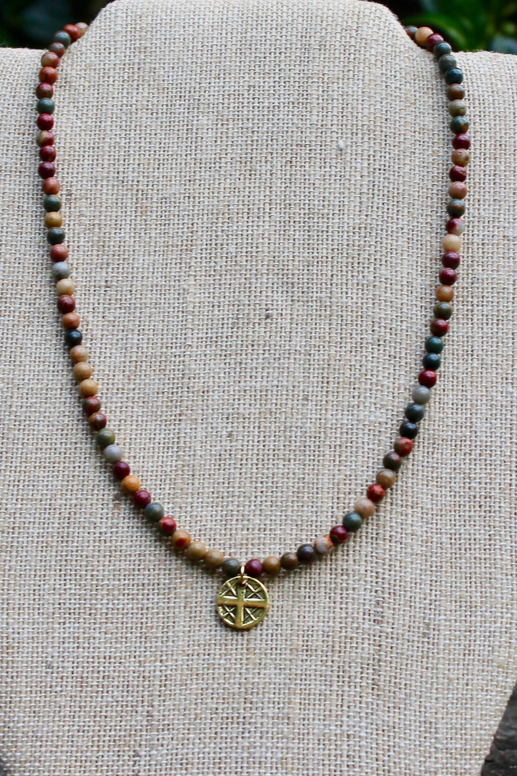 N138GE; Small Goldtone Round Cross ; 4mm Earthtone Picasso Jasper; Approximately 16 inches; ; ; ; Majestees