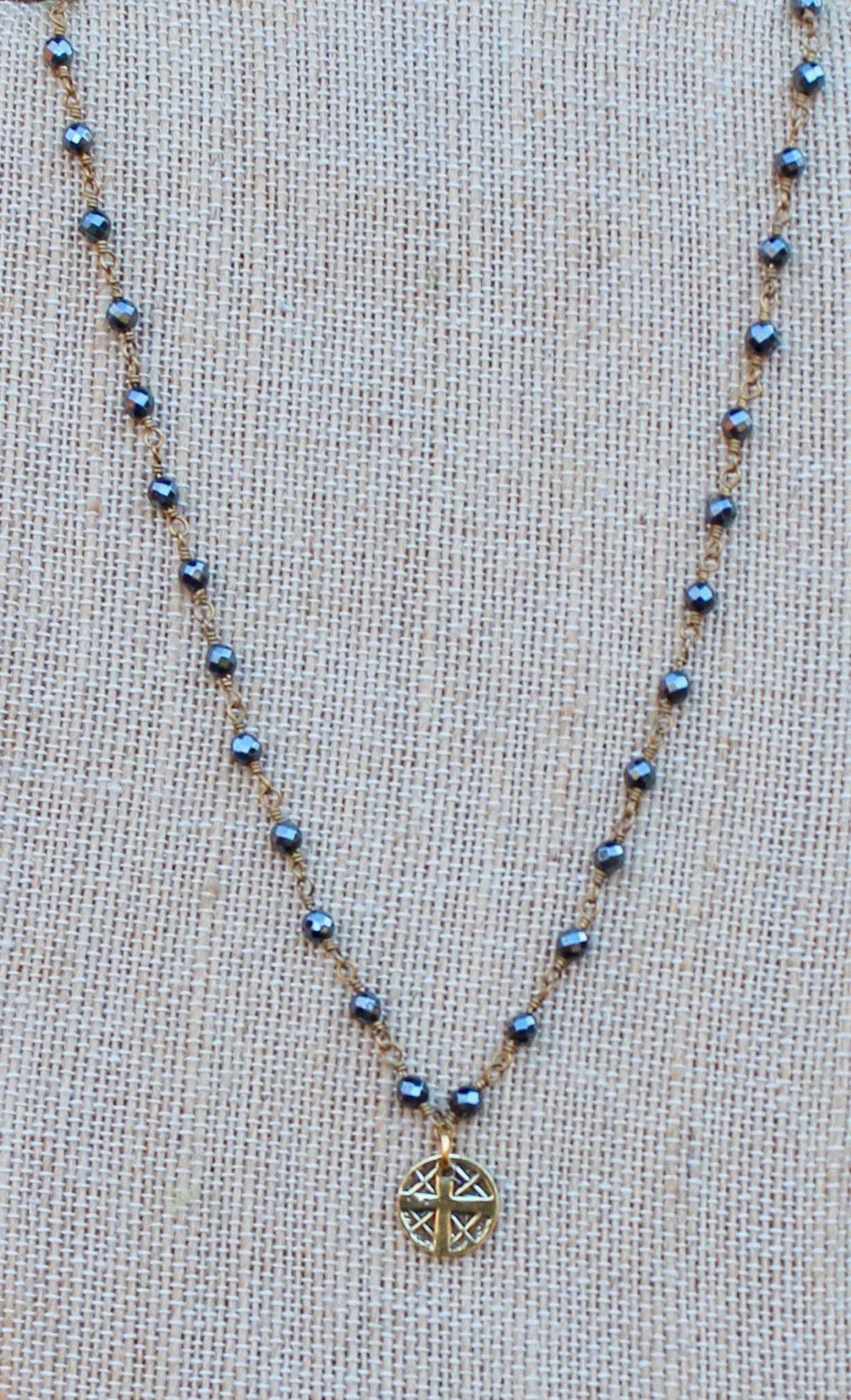 N140GH; Small Goldtone Round Cross ; 3mm Goldtone Hematite Chain; Approximately 16 inches; ; ; ; Majestees
