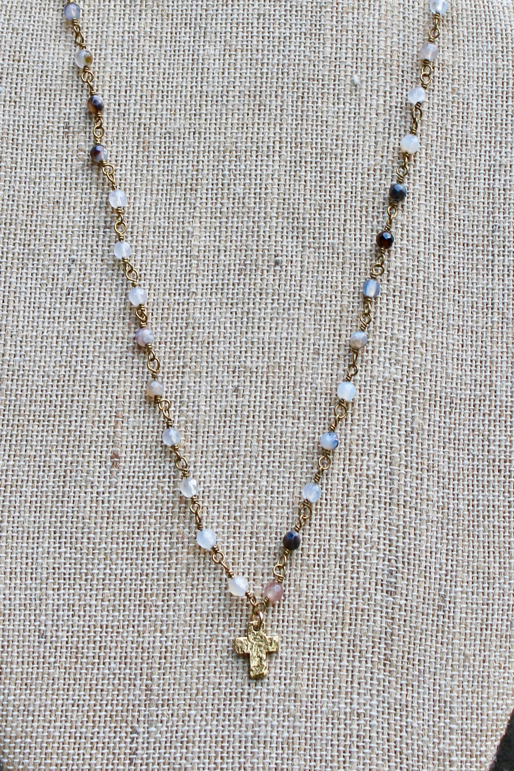 N141GB; Tiny Goldtone Cross; 3mm Goldtone Black Agate Chain; Approximately 16 inches; ; ; ; Majestees