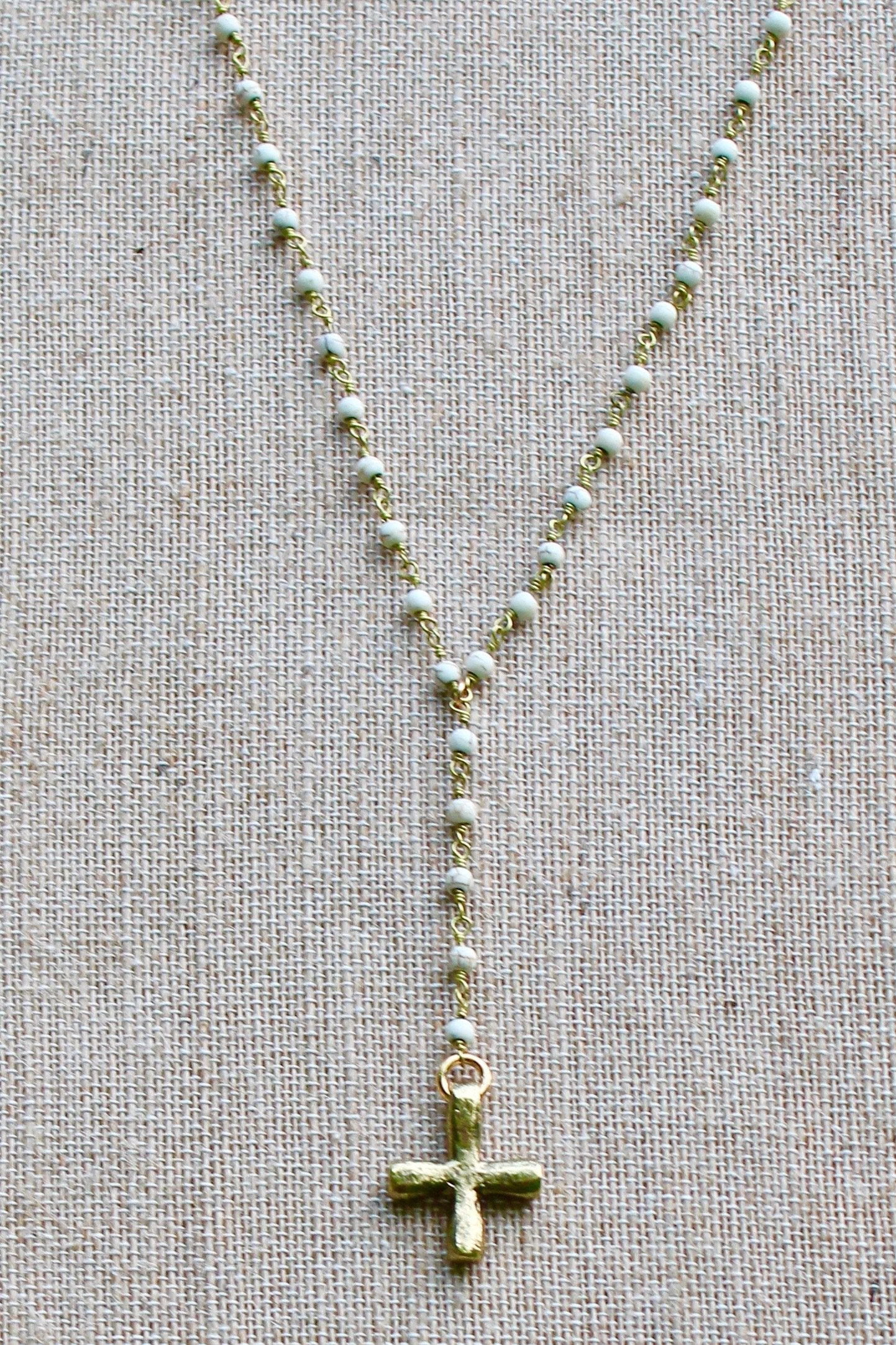 N142GW; Thick Hammered Goldtone Cross; 3mm Goldtone White Stone Chain; Approximately 16 inches with 3 inches Drop; ; ; ; Majestees