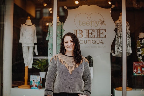 Kristie Case, founder of Teeny Bee Boutique, stands in front of her shop.