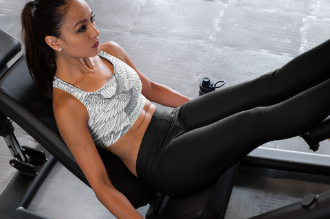 woman working out on a fitness machine
