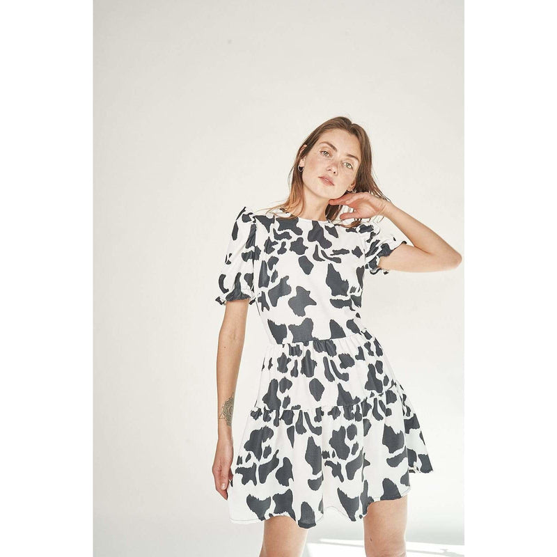 Aroma Couture Dress Short sleeve, loose cow print dress.