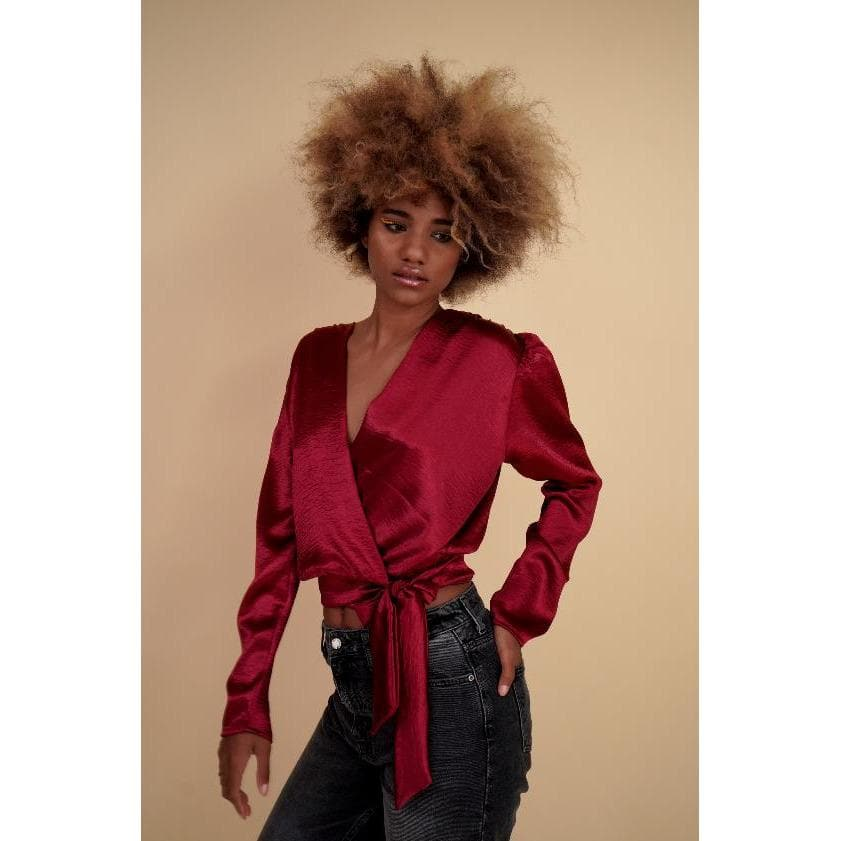 H Apparel tops Crossed, long sleeve satin blouse.