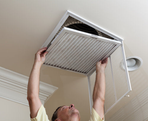 man replacing air filter